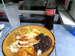 I stuck to the classics with chicken, black beans, rice, fried plantains, some sort of stuff that tasted like ham and bean soup, and coca cola :)