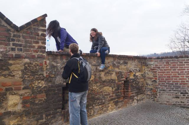 So we decided to climb up onto this wall that was a sheer edge on the other side and Nick had to help us up